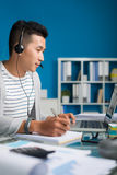 Technical support operator working in the office Royalty Free Stock Photo