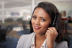 Technical support. Portrait of pretty Malagasy technical support operator Royalty Free Stock Photography