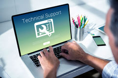 Composite image of technical support text with tool. Technical support text with tool against overhead of masculine hand typing on laptop Stock Images