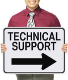 Technical Support This Way. A man holding a modified one way sign indicating Technical Support Royalty Free Stock Image