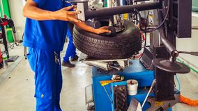 Technical during tire assembler in tire service center stock photo