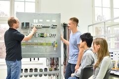 Technical vocational training in industry: young apprentices and. Trainers in the classroom royalty free stock photos