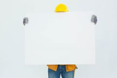 Technicial holding blank billboard Stock Photo