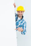Technicial pointing at blank billboard Royalty Free Stock Photos