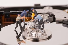 Technicial team miniature people repairing  hard drive Royalty Free Stock Images