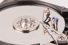 Technicial team miniature people repairing  hard drive Stock Photos