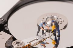 Technicial team miniature people repairing  hard drive Royalty Free Stock Image