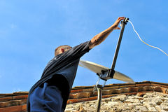 Technician. A technician who repairs a satellite link Royalty Free Stock Images