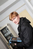 IT technician. The IT technician posing with a fibre optic analyzer at server room Stock Image