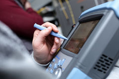 Technician with analyzer. The technician holding a telecom analyzer at site Stock Images