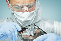 Technician is analyzing the drive disk Stock Photos