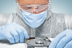 Technician is analyzing the hard disk Royalty Free Stock Images