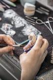 Technician applying ceramics to teeth Royalty Free Stock Photography