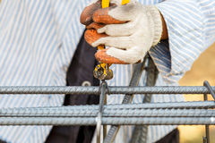 Technician bundle wire steel rod for construction job Stock Photo
