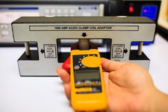 Technician calibration clamp meter with clamp coil adaptor Royalty Free Stock Photography