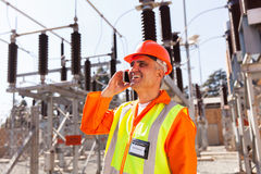 Technician cell phone Stock Photo