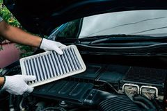 Technician change a new car air filter, Put new air filter on car engine. Maintenance car by yoursalf Royalty Free Stock Photos