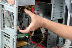 technician changes the fan of a computer Stock Photo