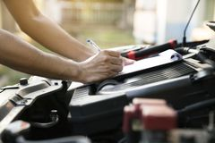 Technician check the engine daily, maintenance and repair concep. T, close up Royalty Free Stock Photography
