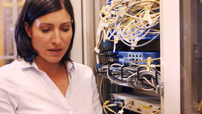 Technician checking cables in a rack mounted server. Close-Up of technician checking cables in a rack mounted server 4k stock video