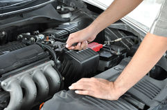 A technician checking car engine Stock Photography