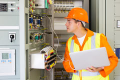 Technician checking computerized transformer Royalty Free Stock Images