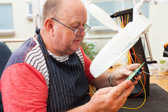 Technician checking electrical Royalty Free Stock Photography