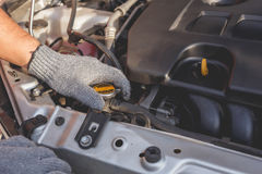 Technician checking or fixing engine of modern car Royalty Free Stock Photos
