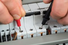 Technician checking fuse stock photos