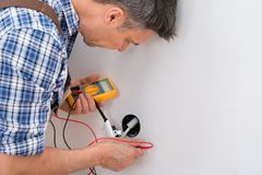 Technician checking socket Royalty Free Stock Photo