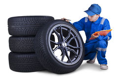 Technician checking tires isolated Royalty Free Stock Image