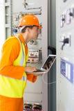 Technician checking transformer royalty free stock photo