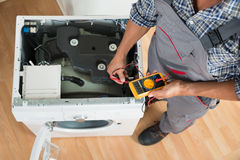 Technician Checking Washing Machine With Digital Multimeter Royalty Free Stock Photo
