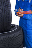 Technician checks tires condition Stock Images