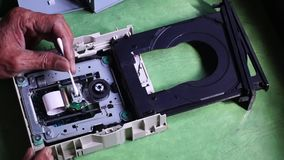Technician cleans laser head or optical lens of DVD Hard Drive. Close up stock video