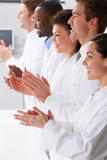 Technician And Colleagues In Laboratory Clapping Royalty Free Stock Image