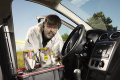 Technician after collecting of odor traces in car Stock Photos
