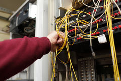 Technician connecting fibre optic. The technician connecting fibre optic on ODF in telecom site Royalty Free Stock Photography