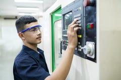 Technician controlling CNC machine. Royalty Free Stock Photos