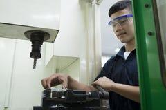 Technician controlling CNC machine. Stock Photo