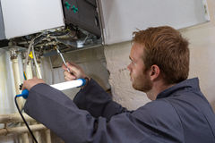 Technician controlling the heating system Royalty Free Stock Photo