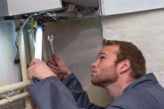 Technician controlling the heating system Stock Photos