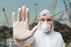 Technician in coverall showing hand as stop gesture Stock Images