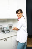 Technician in dental lab. Technician preparing dental impressions in dental lab Royalty Free Stock Photos