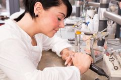 Technician producing a dental prosthesis in a laboratory or workshop Royalty Free Stock Photo