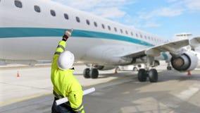 Technician engeneer inspection an aircraft at an airport Stock Photo