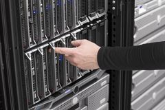 IT Technician Power on Blade Server in Data Center. IT technician / engineer power on and install / removes / replace a blade server in a data center Stock Photography