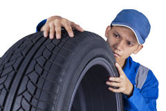 Technician examining a tire Stock Images