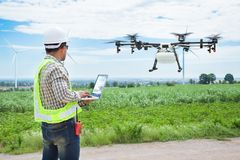 Technician farmer use wifi computer control agriculture drone Royalty Free Stock Photos