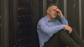 Technician feeling the pressure in server room stock video